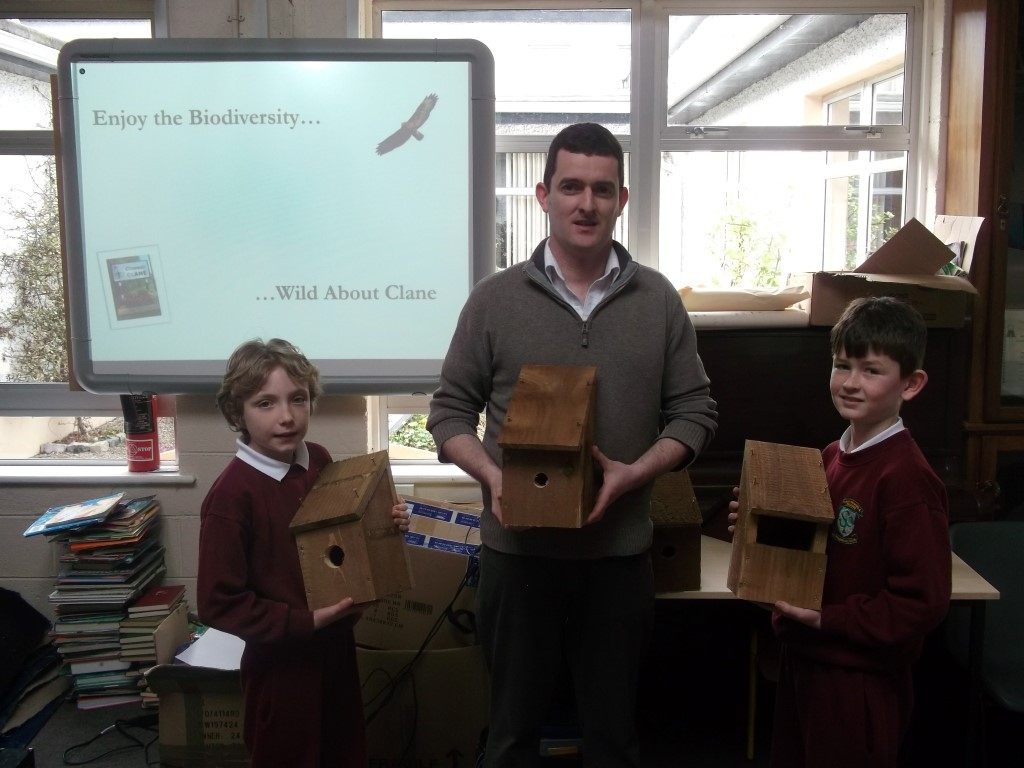 Members of the Green School's Committee presenting their Nest Boxes